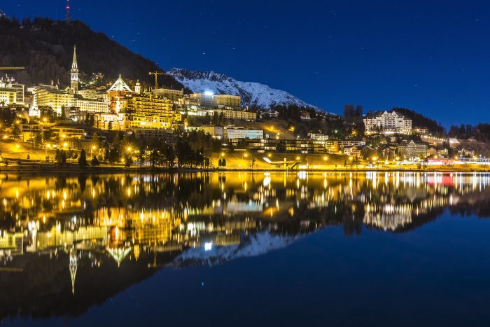 Night landscape of St Moritz reflected in the lake in Switzerland