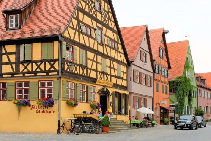 DINKELSBUHL GERMANY - AUGUST 10 2015: Traditional architecture in old town of Dinkelsbuhl. It is old Franconian town one of the best-preserved medieval towns in Europe part of the Romantic Road.